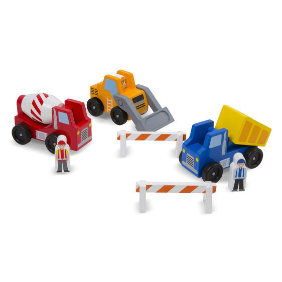 Get to work with this collection of three wooden emergency vehicles and two road barriers! Sturdy wooden construction and moving parts on each vehicle means the dump truck, cement mixer, and front loader will stand up to endless of hours of constructive play. Wooden construction worker play figures fit into each of the vehicles.