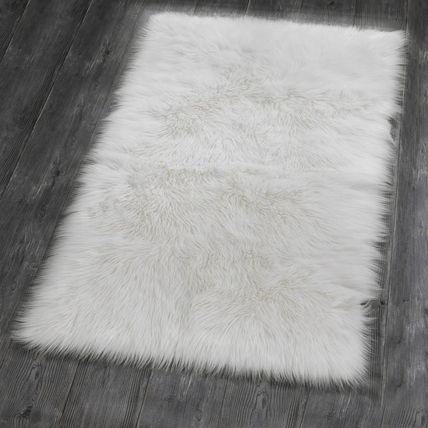 A beautifully sumptuous deep pile faux fur rectangular rug with faux suede reverse. Use on floors, chairs and benches to capture the essence of cosy winter nights at home.