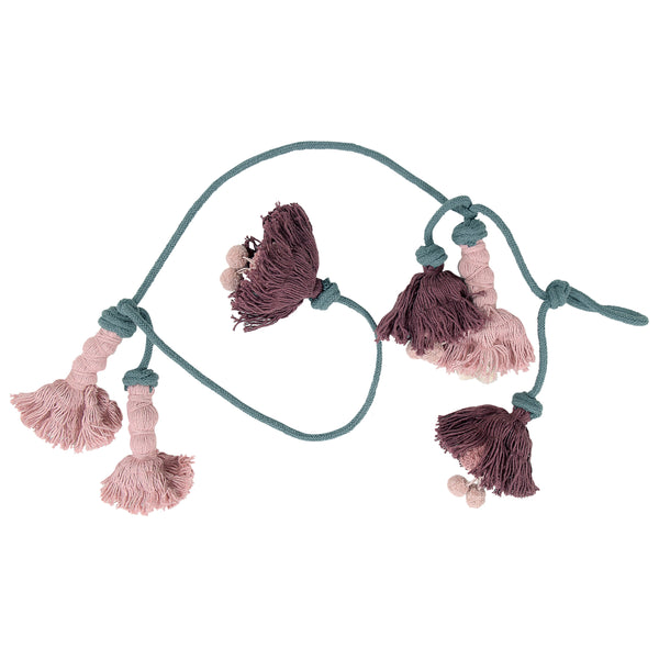 This stunning flower garland is perfect for any part of the home. Every flower is handmade individually by Lorena Canals' expert artisans. The flowers are rose pink and dark aubergine strung on a soft grey garland.
