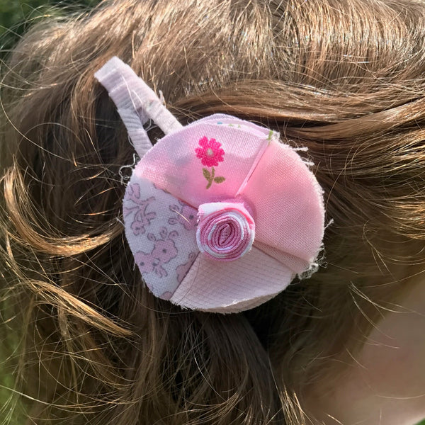 These pink flower hair clips are finished with 100% cotton fabric, decorated with a hand sewed little flower. These hair clips are perfect for girls of all ages!