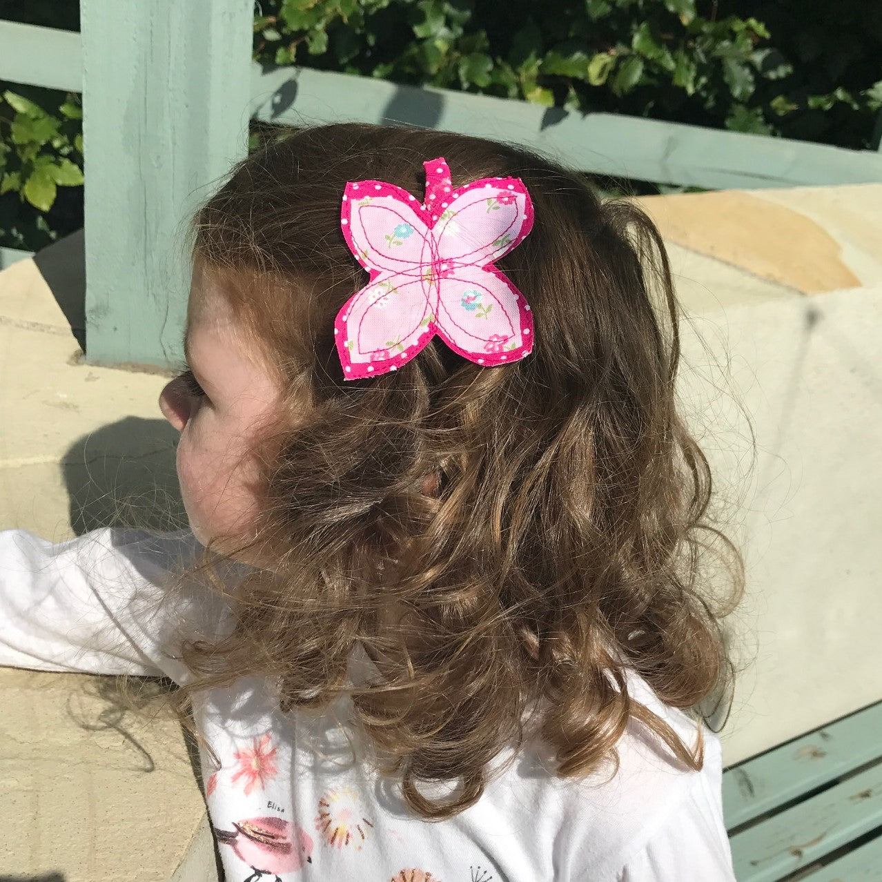These beautiful fuchsia butterfly hair clips are finished with 100% cotton fabric, decorated with a hand sewed little flower. These hair clips are perfect for girls of all ages!