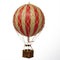 Small red hot air balloon which comes complete with a rattan basket hanging from hand-knotted netting.