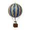 Small blue hot air balloon which comes complete with a rattan basket hanging from hand-knotted netting.