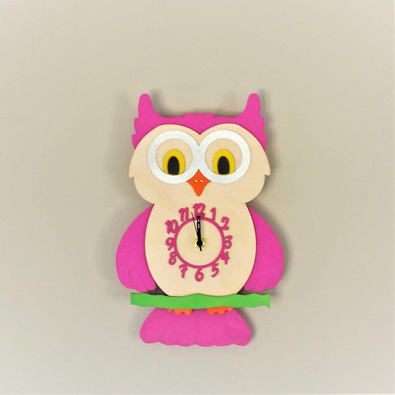 This pretty pink pendulum clock comes alive with a cute owl with moving tail feathers perched on a branch.