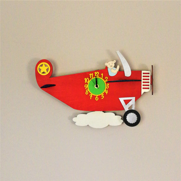 This clock comes alive with a moving cloud pendulum over which the airplane is flying! The clock face is on the red plane which comes complete with wings to give a three-dimensional effect.