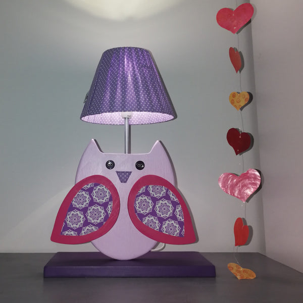 Exquisite side lamp with a purple wooden base and an owl design. Constructed from wood and fabric, the purple and pink owl is simply beautiful.