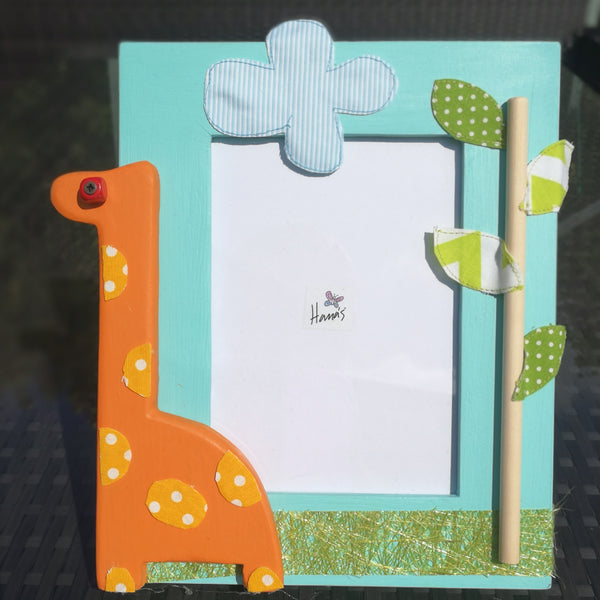 This beautiful Italian hand-crafted natural wood photo frame comes with a giraffe theme. The amazing giraffe, trees and cloud detail is attained through an array of layered fabrics and painted wood giving a three-dimensional effect.