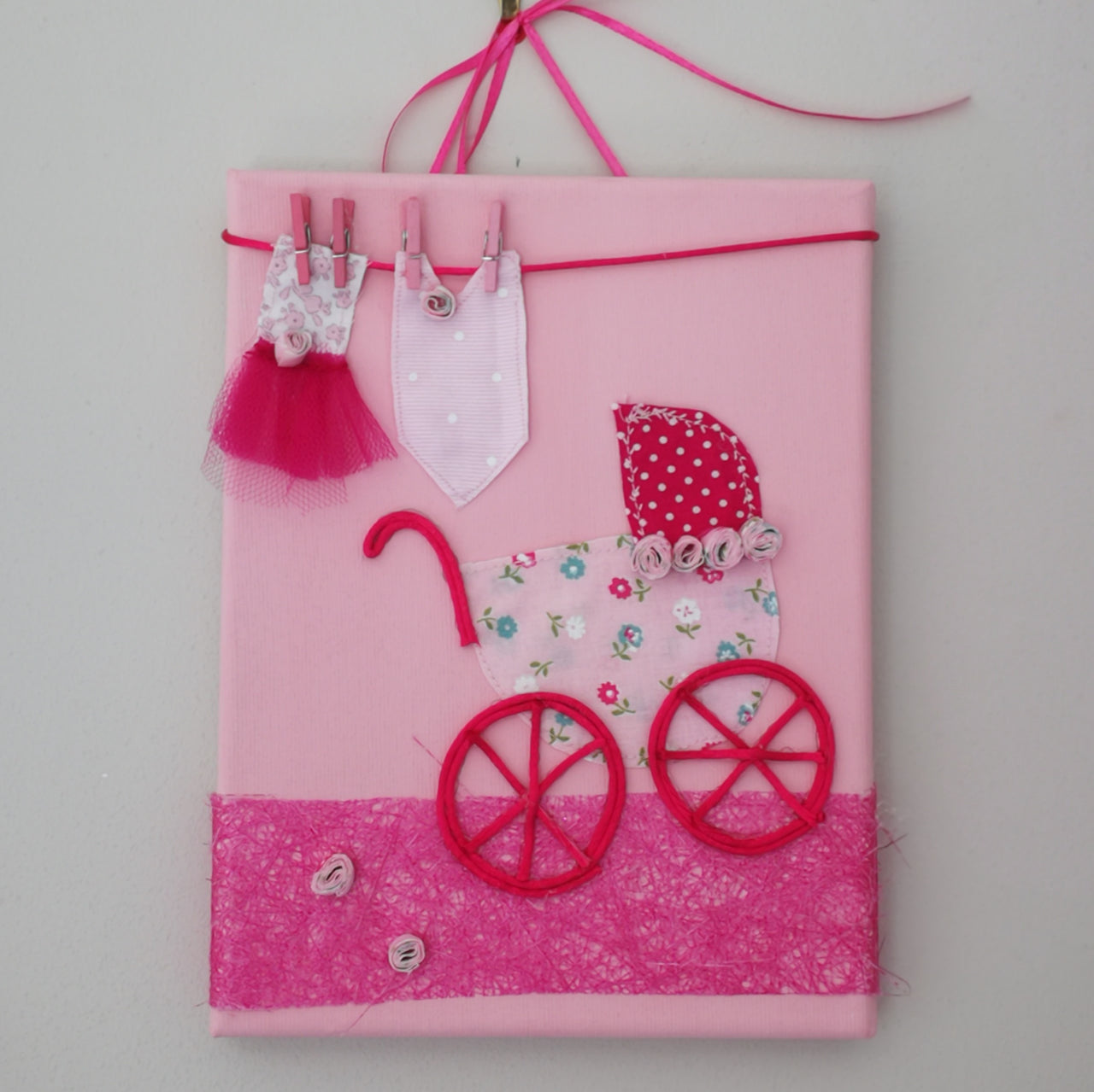 A beautiful Italian hand-crafted baby picture complete with an old style pram and washing line. It is the ultimate gift for a new baby or for their christening or baby-naming ceremony. Here in pink.