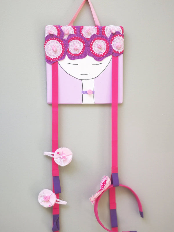 Organizing your little girl's cute bows and head band will be more stylish and fun with our headband holders!