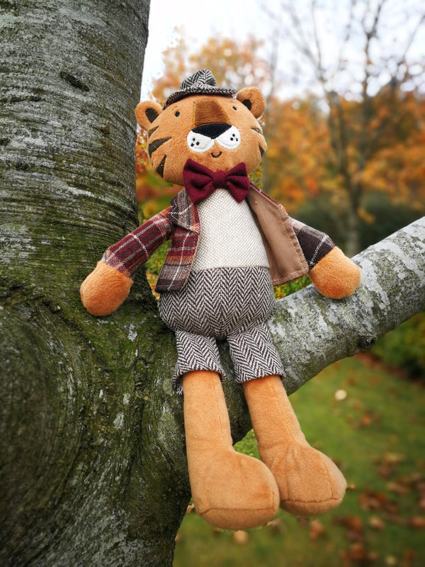 Meet Rob, the smartest dressed tiger you will ever see. Rob is very distinguished in his tweed hat, matching trousers, tartan jacket and bow tie.