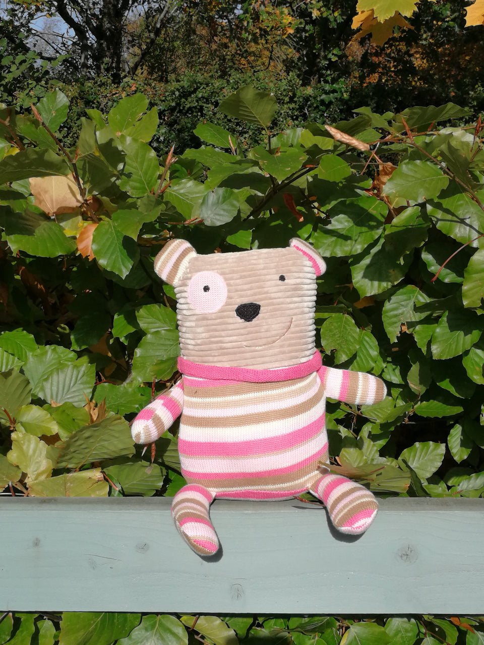 Hermione dog is made from ribbed and knitted fabrics for little fingers to explore.  With a pink striped tummy, arms and legs designed for small hands to grab. A lovely gift for a newborn or child.