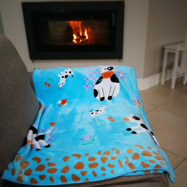 Supersoft reversible farm themed blue baby blanket . Perfect for baby in the pram or as a playmat.