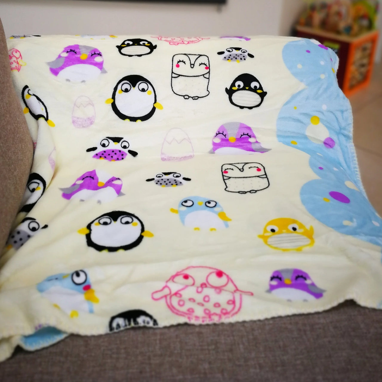 Supersoft reversible Penguin, Owl and Friends cream baby blanket. Perfect for baby in the pram or as a playmat.