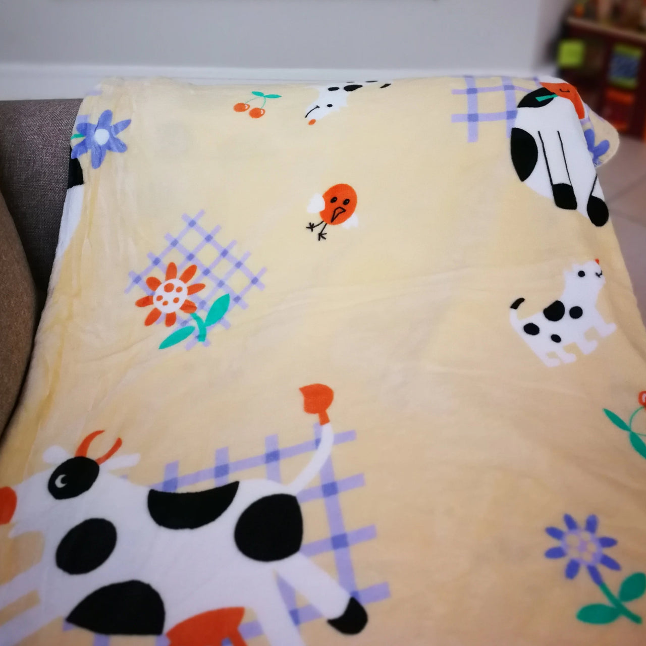 Supersoft reversible farm themed yellow baby blanket . Perfect for baby in the pram or as a playmat. Young children will love to snuggle up in it too. A great gift for a newborn or for a baby shower.