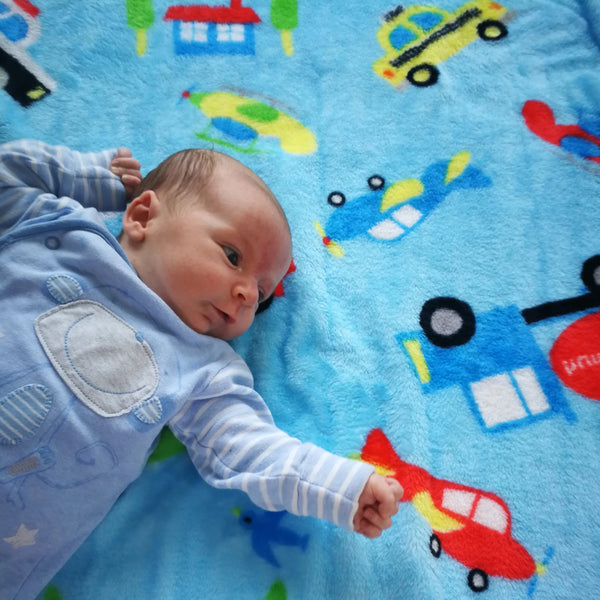 Supersoft reversible Transport blue baby blanket. Perfect for baby in the pram or as a playmat. Young children will love to snuggle up in it too. A great gift for a newborn or for a baby shower.