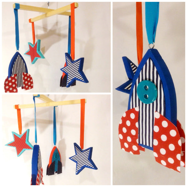 This beautiful baby mobile with Rockets and stars is perfect for a baby boy or girl nursery.