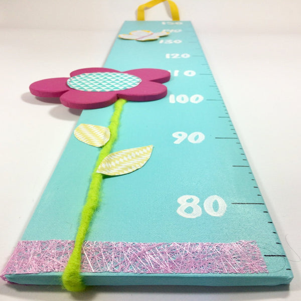 Flower height chart on turquoise canvas base with a pink flower detail.
