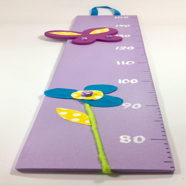 Butterfly height chart on a purple canvas with stunning butterfly and flower details.