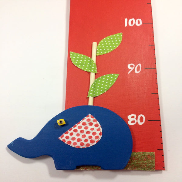 Elephant height chart with a close up of a blue elephant on a red canvas background.
