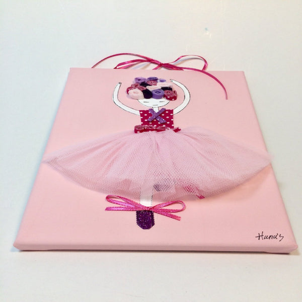 Picture of a ballerina on a painted pink canvas with layered fabrics to provide a three-dimensional effect.