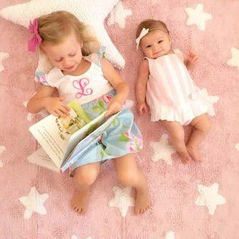 Complete your child's room with this brightly coloured Lorena Canals star rug. White stars on a pink background, a classic design that you will always love and that suits the decor of any child's room. Machine-washable. Handmade by artisans. Only natural dyes are used so it is safe. 100% cotton, so it is light, soft and flexible.