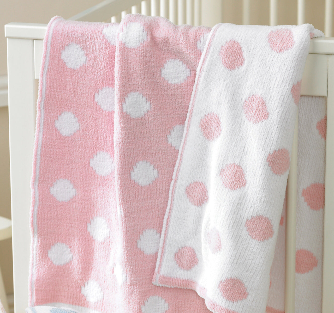 Super soft reversible spotted baby blanket in pink and white.  Perfect as a playmat or in the pram, young children will love to snuggle up in it too.  A great gift for a new born or baby shower.
