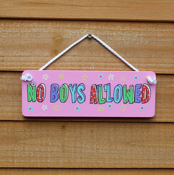 "Pink painted wooden board with motif ""No boys allowed"" in colourful writing comes with a string for hanging from the door."