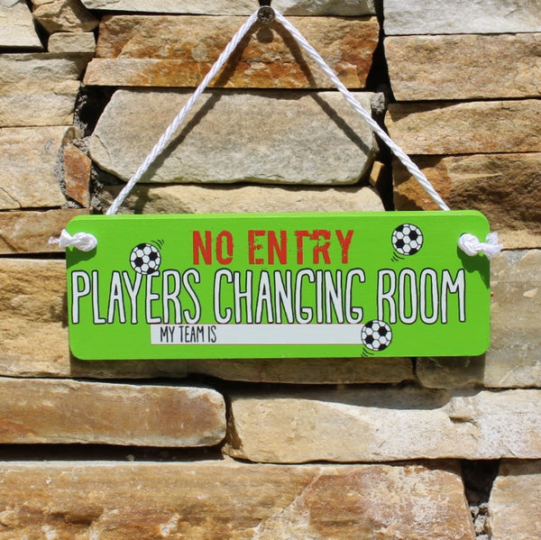 "Green painted wooden board with motif ""No entry - players changing room"" comes with a string for hanging from the door."