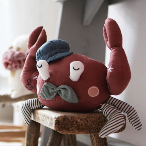 Cuddle up with this cute little Rusty Red Crab from Picca LouLou. This Red crab features beautiful detailing, with a grey hat and striped legs. With his grey antennas, he is full of vintage charm.