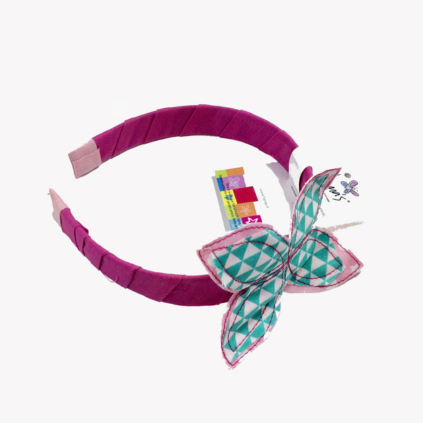 Our Fuchsia Butterfly Headband is finished with 100% cotton fabric, decorated with a hand sewn little butterfly. This headband is perfect for girls of all ages and it is a lovely piece to have!