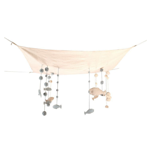 This stunning Sea Sky hanger is made up of a natural undyed cotton canvas fabric, hanging from small cords tiny bubbles and fish-shaped mini cushions. There is a small cotton cord at each end of the canvas so that it may be hung on the bedroom ceiling. Hand-made, each hanger is unique. Thanks to its colors and soft, rounded shapes, this beautifyl sky hanger is perfect for a childrens room or play room!