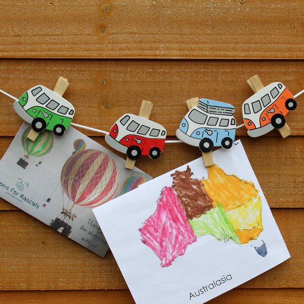 Beautiful camper van wooden pegs and over a metre of cord for hanging up photos, pictures or cards. Picture of pegs on their string.