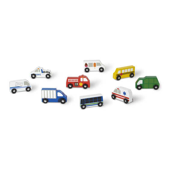 The nine-piece set includes a recycling truck, mail truck, school bus, tow truck, fire engine, ice cream truck, city bus, ambulance, and delivery truck, each approximately four inches long.