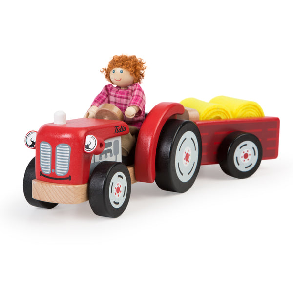 Down on the farm you will find the happy farmer and his shiny red tractor tending to livestock, harvesting crops and even transporting hay bales in this cute, shiny red tractor and trailer from Tidlo.