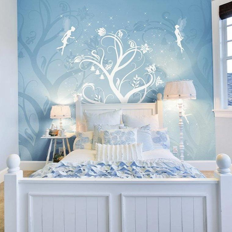 Bring magic into your home with this twinkling wall mural. Transform any room into a magical world with fairies and sparkling stars. The blend of blues is detailed with white silhouettes of a blooming tree and fluttering fairies.