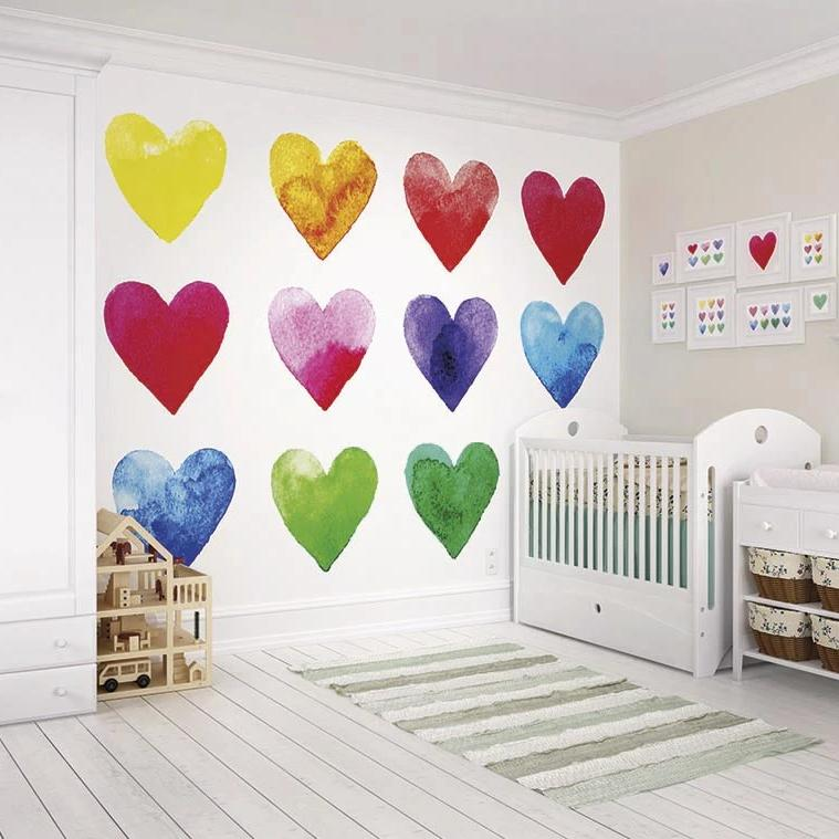 Colour my heart wall mural. A simple white background gives full attention to the beautifully coloured hearts which adorn the full width and height of this wonderful mural. With each heart coloured using the full rainbow spectrum, this mural is sure to suit any interior.
