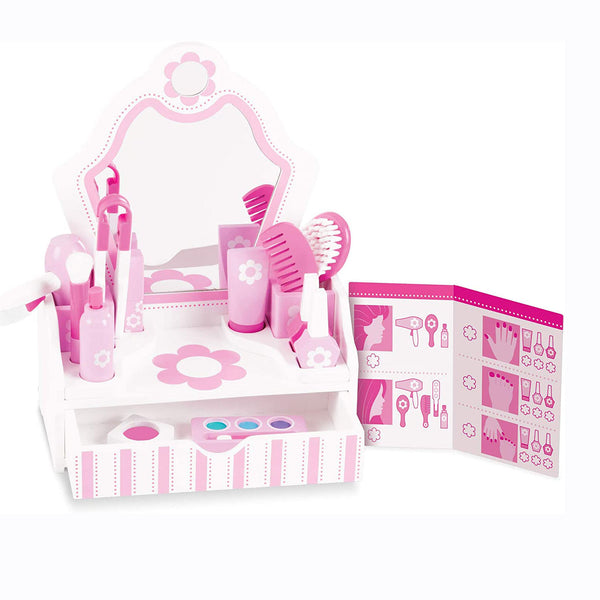 Add glamour and style to playtime with these wooden beauty essentials for make-believe makeovers! The 18-piece set includes a sturdy white and pink vanity with mirror and storage drawer. The wooden pieces include a hair dryer, hair spray, hair straightener, flip-top lotion bottle, lipstick, two nail polish bottles, blush, makeup brush, eye shadow and applicator, comb, and brush.