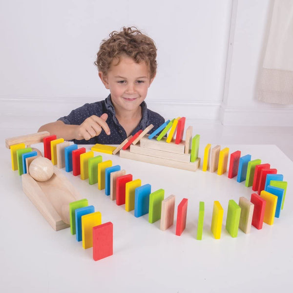 This vibrant domino run contains rectangular wooden pieces in yellow, blue, red, green and raw wood. The dominos are designed to be lined up close together and then knock each other over in sequence when the first in line is pushed. Set includes a ramp, ball, comb, direction changers and stairs. Your rascals can get creative with items such as books and boxes in your home to create their own interesting and experimental sequence. Encourages patience, problem solving, colour recognition and imaginative play.