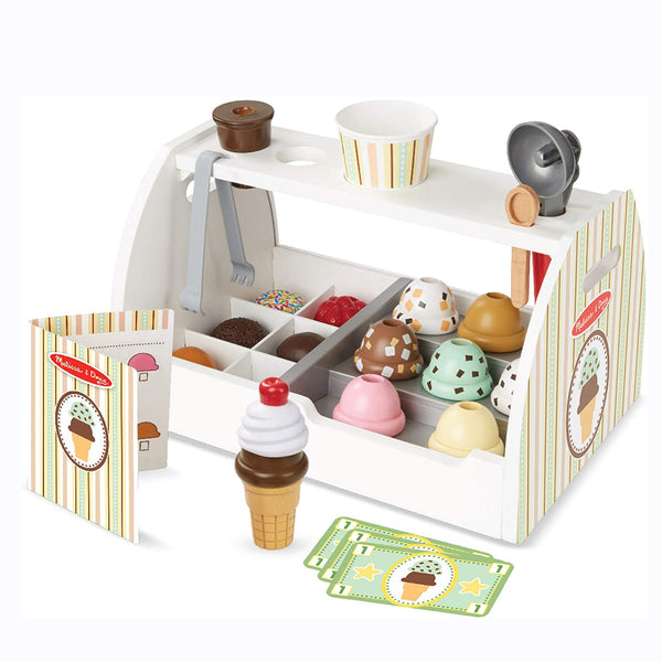 Scoop up some tasty treats with this 28-piece pretend play ice cream counter from Mellissa and Doug! The sturdy wooden tabletop counter holds eight wooden scoops of different-flavored ice cream, six assorted toppings, two cones, a plastic cup, an ice cream scooper, tongs, and a wooden spoon.
