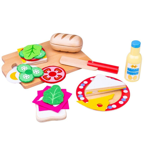 Your little ones can get creative in their pretend cafe with this colourful wooden sandwich making set from Bigjigs! Create a yummy sandwich with the wooden slices and felt fillings. Perfect for interactive role play sessions, to develop vocabulary and learn the importance of a healthy and balanced diet. Includes a plate, chopping board and knife, a ciabatta, bread slices, mayonnaise, lettuce, cucumber, cheese, egg and tomato. Made from high quality, responsibly sourced materials.