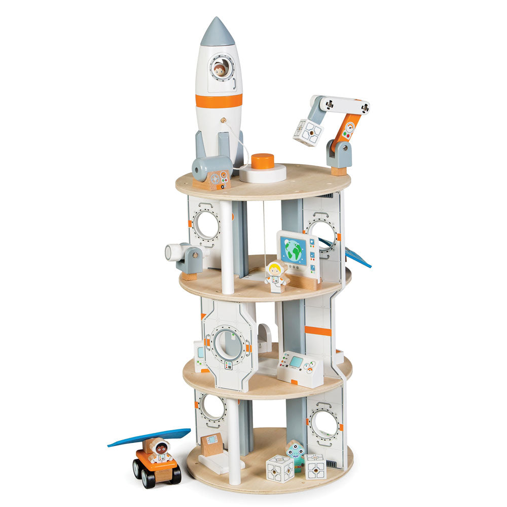 Blast off into space with this 22 piece Space Station playset from Tidlo! Your little astronaut can shoot into space in the rocket that uncouples to simulate a real life rocket take off and docking. As you are nearing your approach jettison the rocket's module and dock with the station's airlocks to climb aboard. Explore the station using the working lift, observe the stars with the telescope and computer equipment, visit the hydroponic garden and get some exercise on the treadmill.