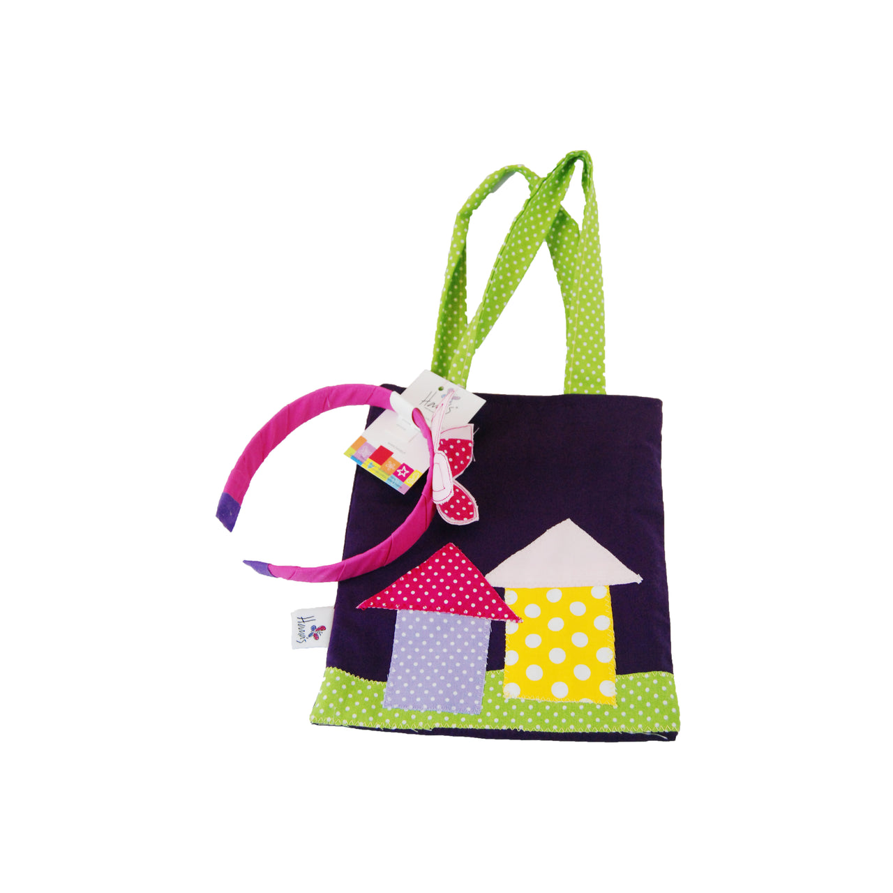 The dark purple houses bag and headband is one of our best seller gifts for girls! Hand sewn of 100% cotton fabric and layered with colourful pieces of fabric, the bag is reversible.