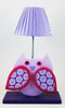 Exquisite side lamp with a purple wooden base and an owl design. Constructed from wood and fabric, the purple and pink owl is simply beautiful. The lampshade is handmade from matching purple fabric with white spots.