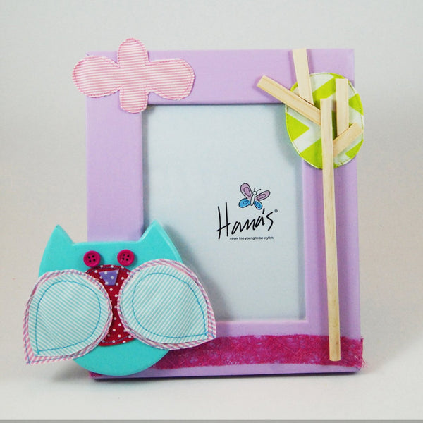 Lilac photo frame comes with a turquoise owl and tree/cloud details.  The wooden frame is hand-painted and the amazing owl, tree and cloud details are attained through an array of layered fabrics and painted wood giving a three-dimensional effect.