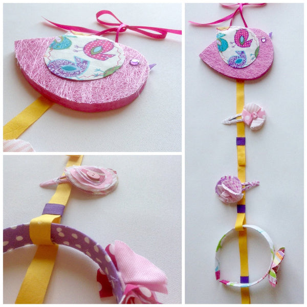 Three images of the little bird headband and hairclip holder. Designed to be hung on the wall, the little bird is made from painted wood with layered fabric. Attached to the little bird is a 44cm long ribbon for holding hairclips and notches for holding headbands.