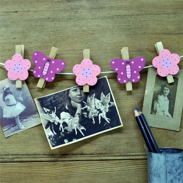 Beautiful butterfly and flower wooden pegs and over a metre of cord for hanging up photos, pictures or cards.