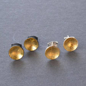 silver and gold pool studs