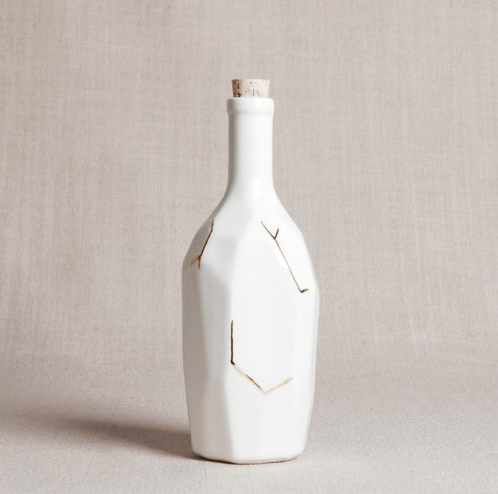 Honeycomb Studio white faceted bottle with gold