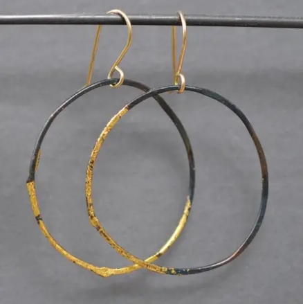 large steel and gold hoops