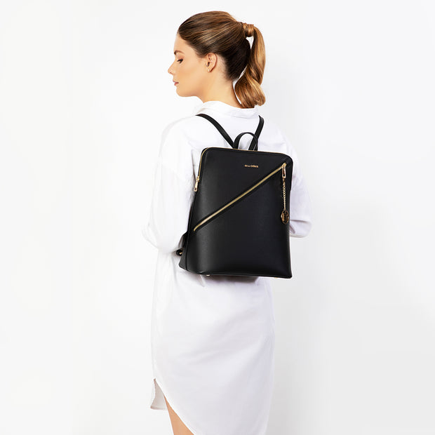 Eila Cherie Womens lifestyle brand, leather travel backpack on model in the black color onyx